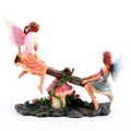 Cute Flower Fairies Playing on Seesaw Figurine